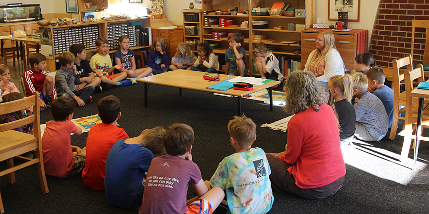 Elementary students participating in a group lesson on grace and courtesy.